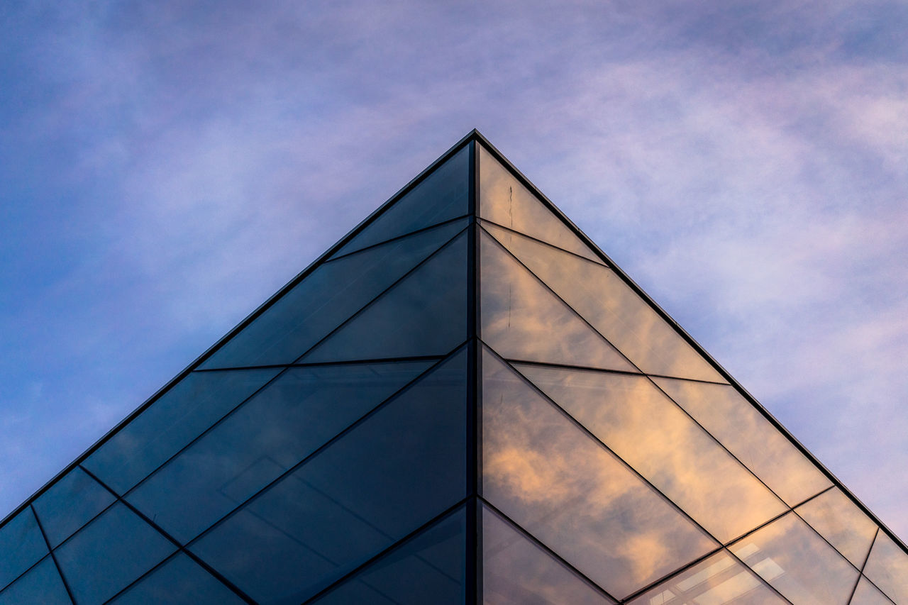 Low Angle View Of Triangle Shape Modern Building Against Sky