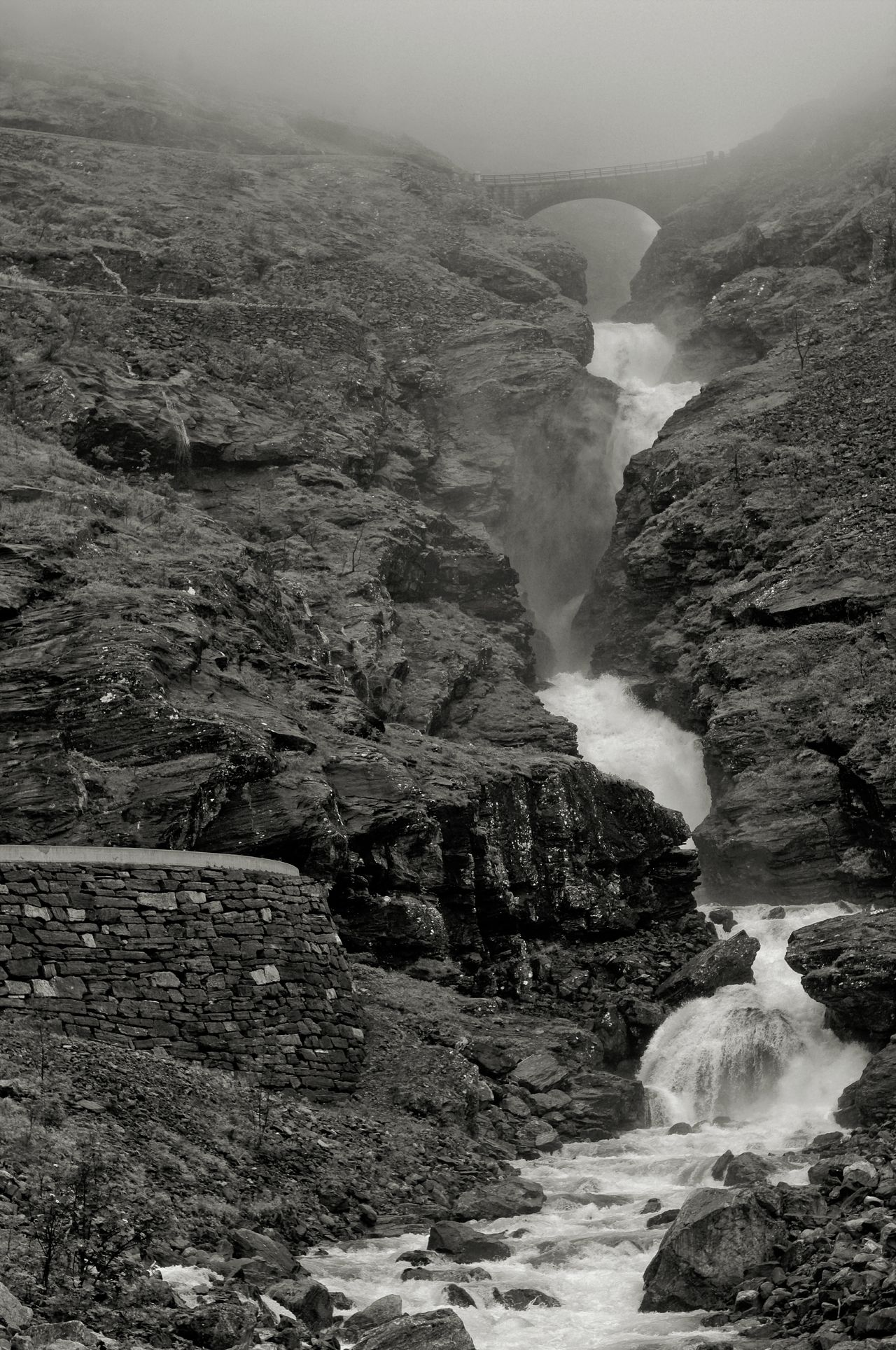 Norway Trollstigen Norway🇳🇴 Black And White Outdoors Landscape Nature No People Vertical Monochrome Photography Fujifilm X-e1 Low Clouds Trollstigen Awesome Nature