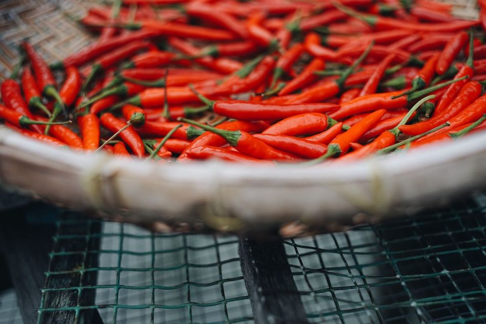 Food And Drink Red Food Freshness Red Chili Pepper Spice Vegetable Healthy Eating Human Hand Close-up Large Group Of Objects Day Outdoors
