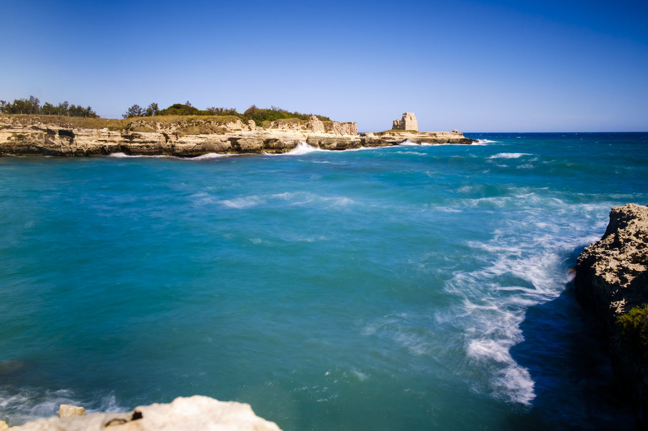 Beauty In Nature Blue Built Structure Clear Sky Cliff Day Horizon Over Water Italy Melendugno Nature No People Outdoors Puglia Rock - Object Rock Formation Salento Scenics Sea Sky Summer Sunlight Tranquility Travel Destinations Water Live For The Story