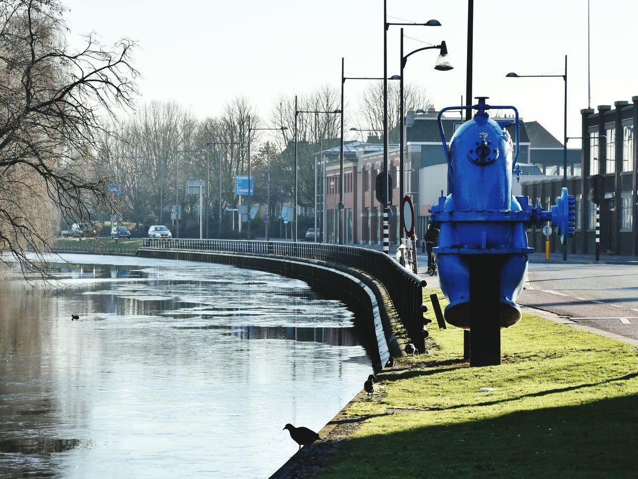 Pump Industrial Equipment Blue Canal Frozen Adapted To The City Canal Helmond Zuidwillemsvaart Birds Waterfowl Coots Trees Reflections Ice Grass Road Lampposts Industrial Heritage Fence Sunlight And Shadow Industrial Buildings Windows The City Light