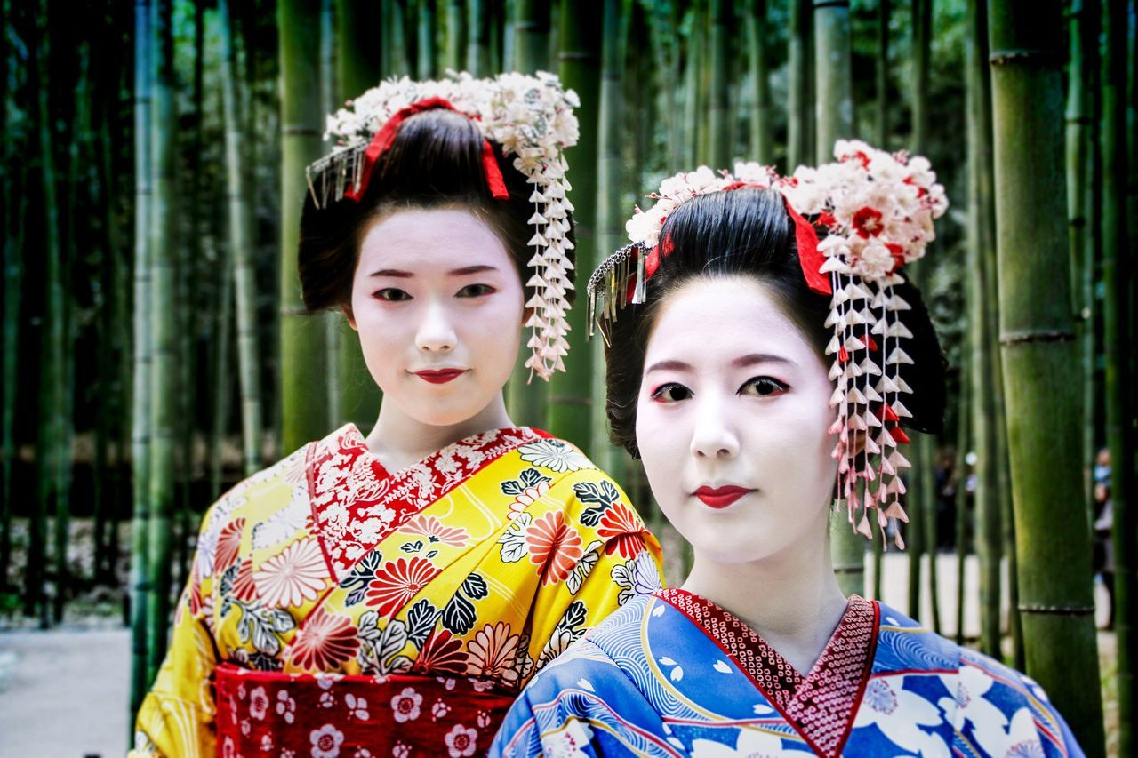 traditional clothing, young adult, real people, kimono, beautiful woman, young women, two people, waist up, fashion, cultures, lifestyles, portrait, outdoors, looking at camera, beautiful people, make-up, beauty, red, day, beauty in nature, women, people