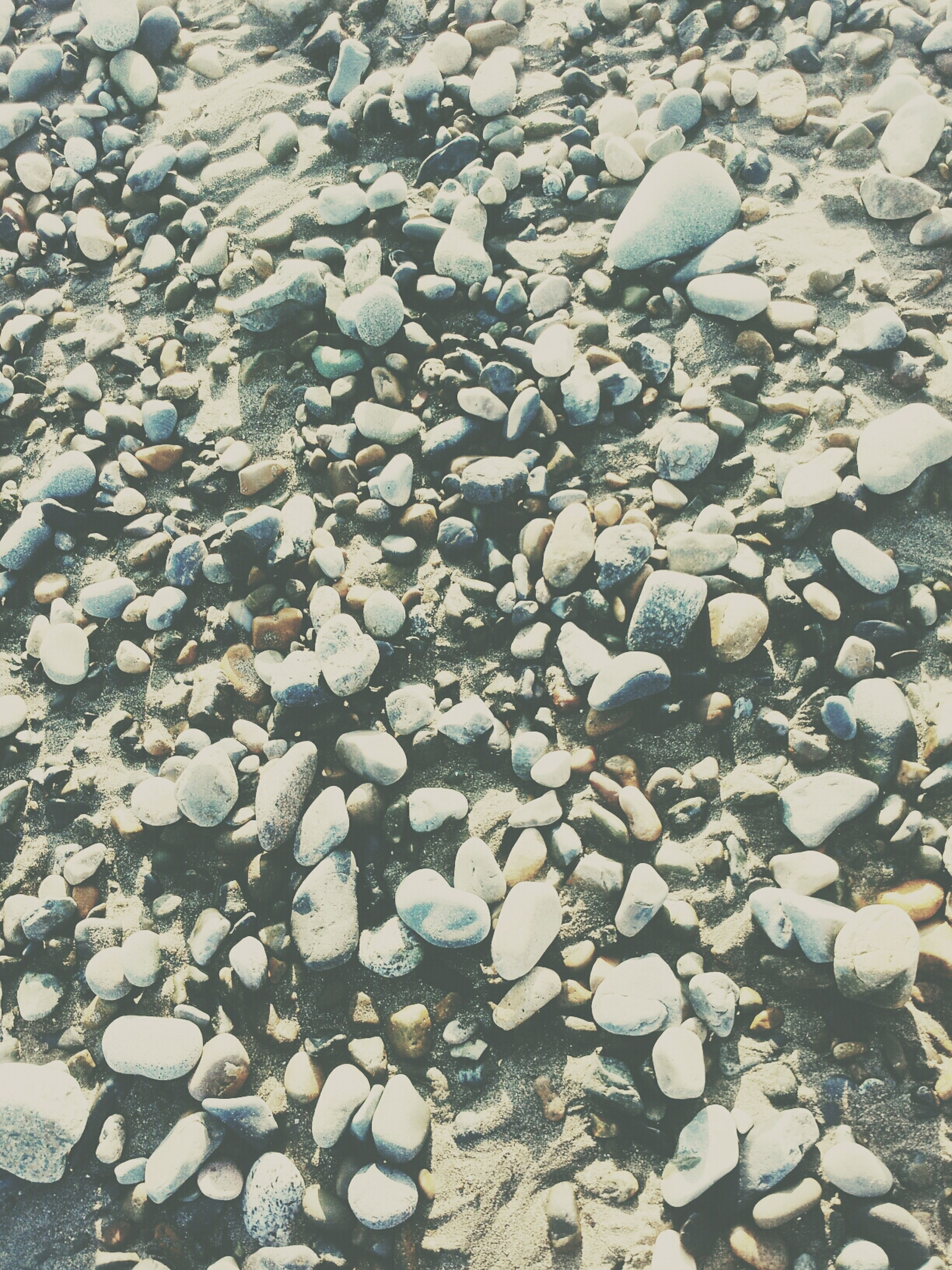 pebble, stone - object, abundance, high angle view, rock - object, nature, large group of objects, beach, full frame, backgrounds, day, stone, tranquility, outdoors, beauty in nature, no people, textured, sunlight, shore, rock