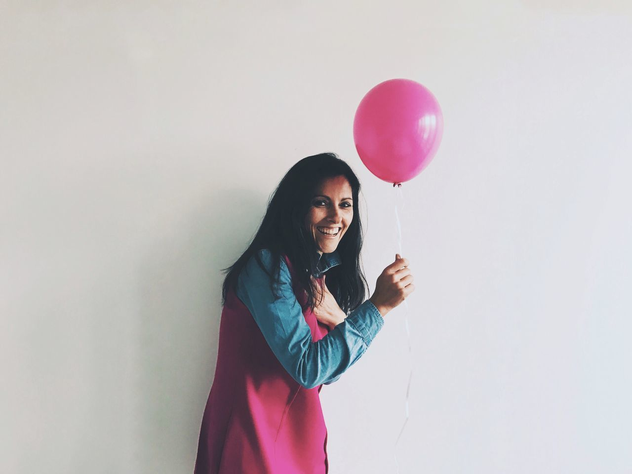 Waist Up One Person Smiling Standing Happiness Balloon Lifestyles Real People Looking At Camera Holding Portrait Leisure Activity Beautiful Woman Women Cheerful Young Adult Day Pink People