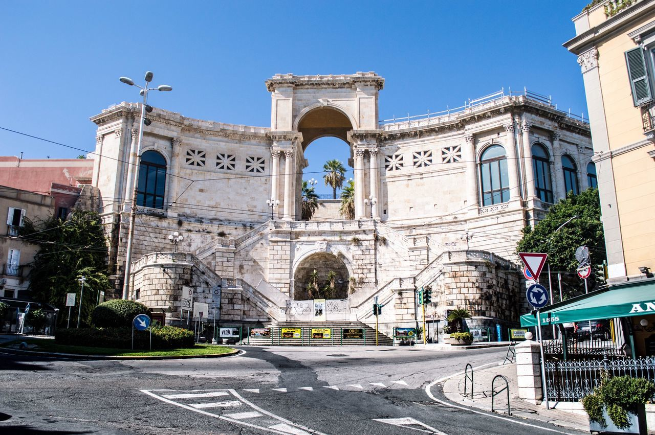 Architecture Building Exterior Street Travel Destinations Built Structure Blue Tourism City Outdoors History Cultures Clear Sky Traffic Circle Day Statue (null)Sculpture Sky Cagliari Urban City Cagliari Italy No People EyeEm Best Shots EyeEm Gallery EyeEm