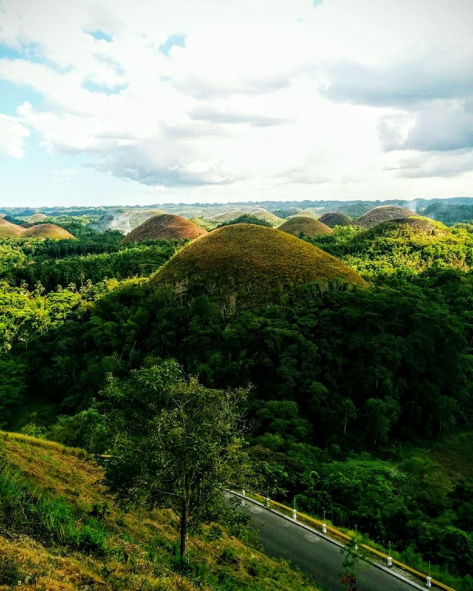 Tourist Attraction  Nature_collection Nature Chocolatehills Hills, Mountains, Sky, Clouds, Sun, River, Limpid, Blue, Earth Hills And Valleys Hills Ecotourism Bohol Naturephotography Nature Photography Natureshots Naturegram
