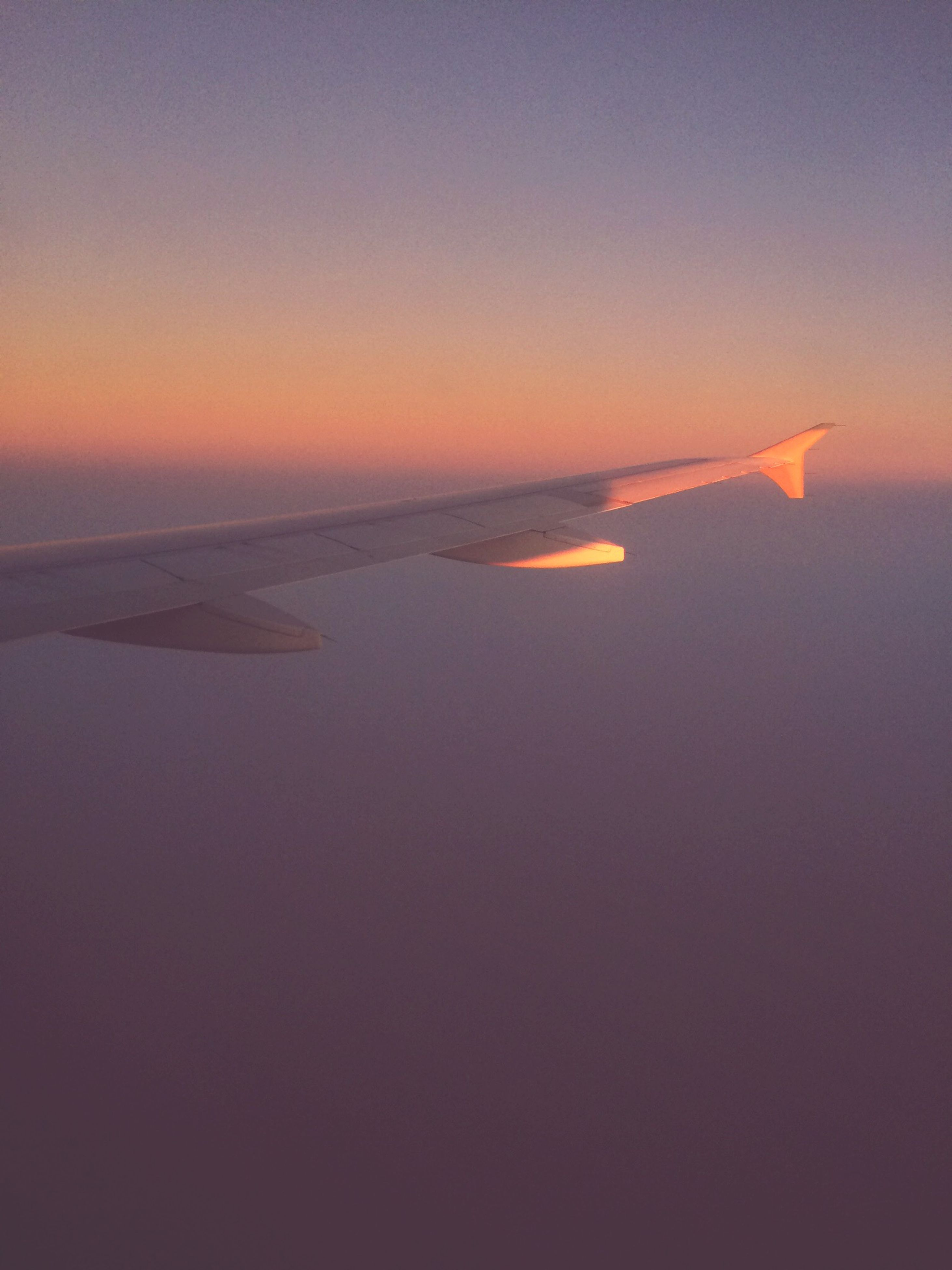 airplane, flying, sunset, aircraft wing, air vehicle, transportation, aerial view, mode of transport, scenics, sky, beauty in nature, part of, nature, mid-air, cropped, orange color, travel, tranquil scene, copy space, airplane wing