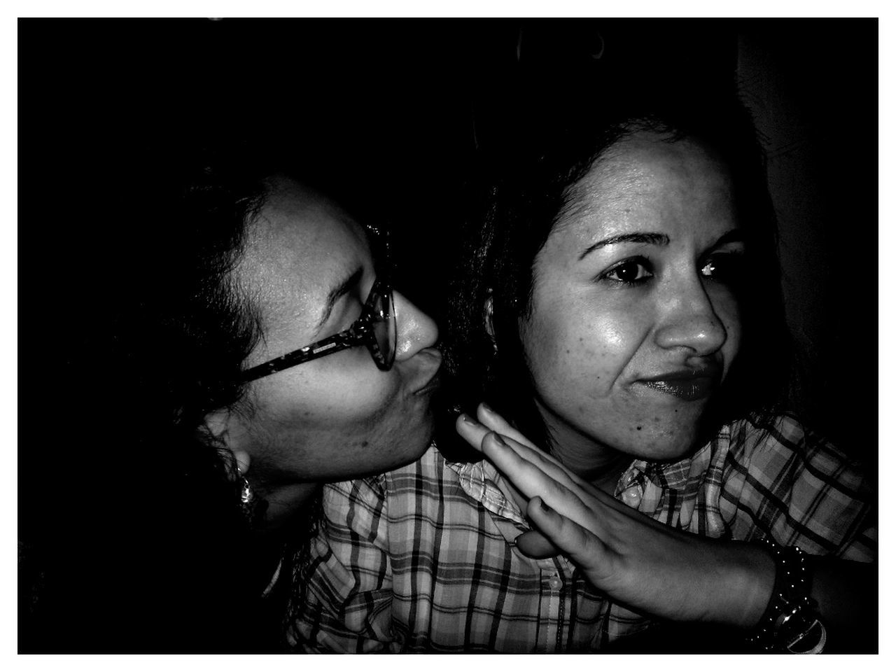 two people, togetherness, real people, head and shoulders, bonding, childhood, night, girls, close-up, friendship, black background, indoors, young women, young adult, people