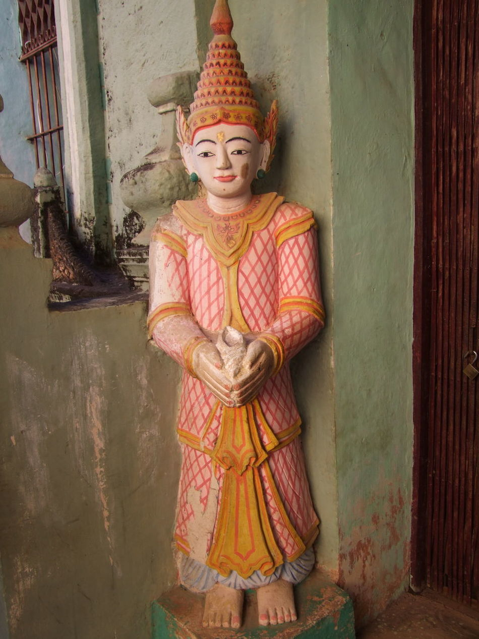 One of Two Deities outside one of the Pakokku Rock Caves (11th century) Buddhism Buddhist Art Buddhist Culture Buddhist Deity Composition Deity Famous Place Full Frame Full Length Fun Human Representation Myanmar Natural Light Outdoor Photography Pakokku Pink And Gold Colour Place Of Pilgrimage Place Of Prayer Place Of Worship Religion Tourism Tourist Attraction  Tourist Destination Travel Destination