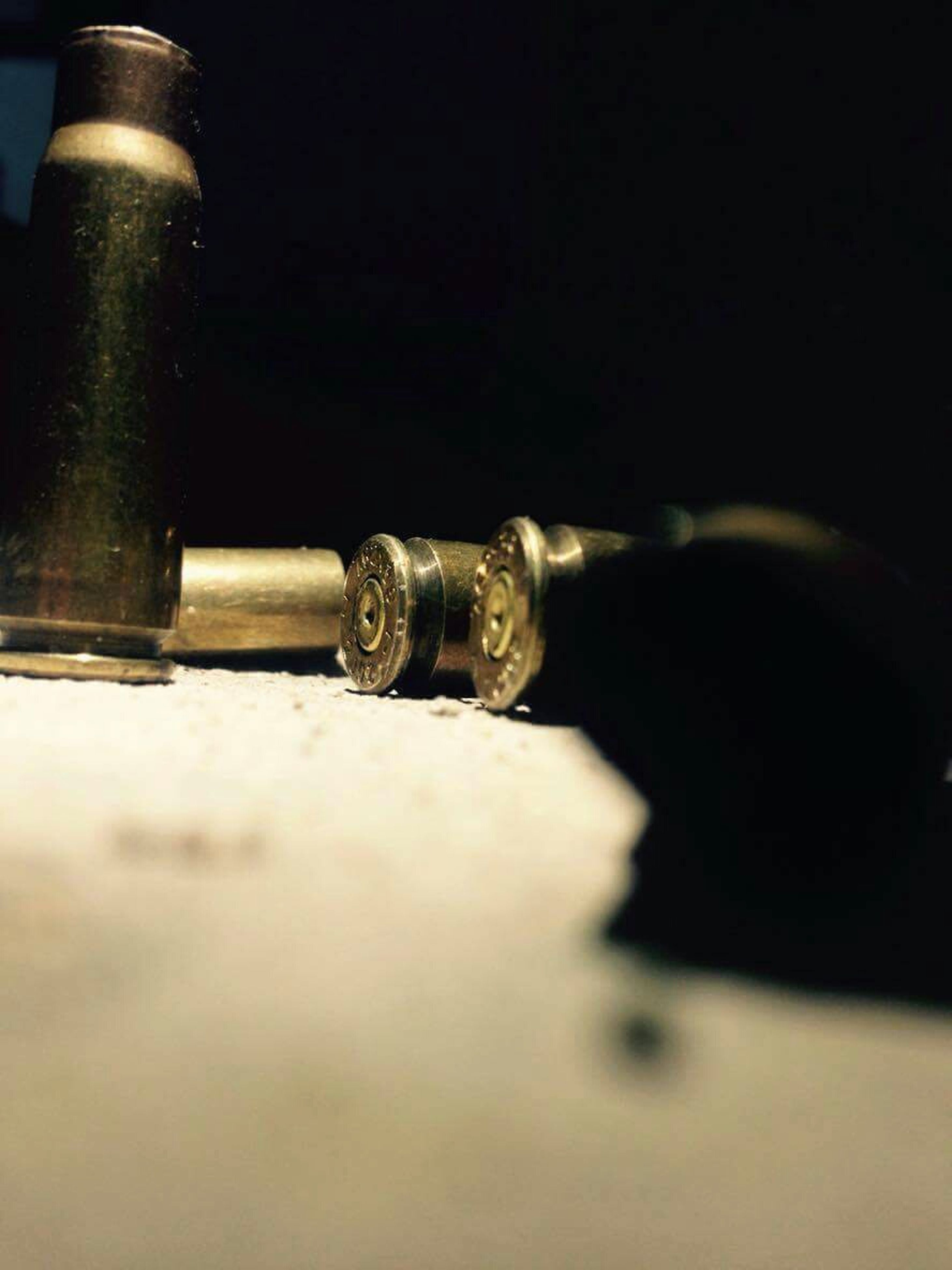 single object, selective focus, metal, close-up, man made object, supported, studio shot