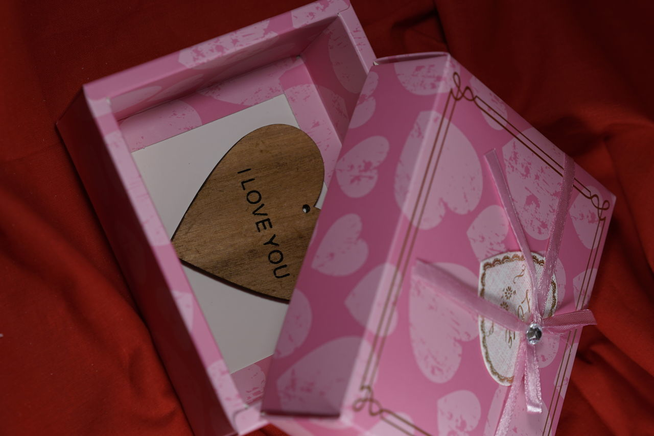 communication, high angle view, text, close-up, still life, indoors, love, no people, heart shape, pink color, savings, day