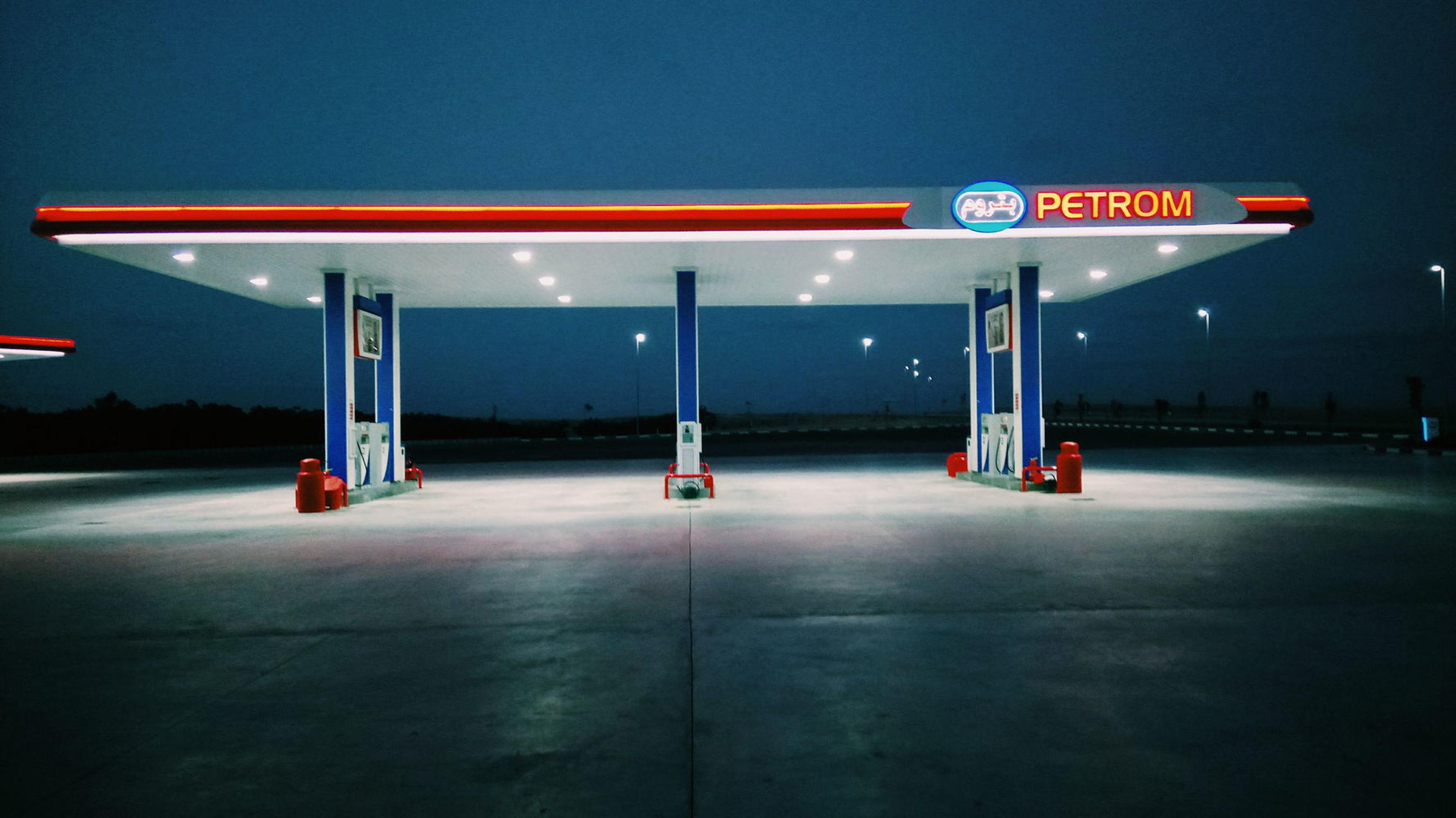 communication, gas station, text, night, illuminated, transportation, no people, fuel pump, refueling, road, outdoors