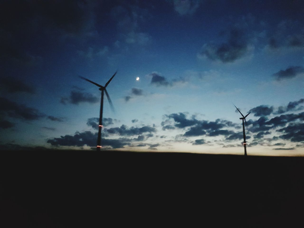 wind power, wind turbine, alternative energy, environmental conservation, windmill, renewable energy, fuel and power generation, industrial windmill, sky, rural scene, silhouette, low angle view, field, outdoors, technology, no people, nature, cloud - sky, sunset, traditional windmill, scenics, beauty in nature, day