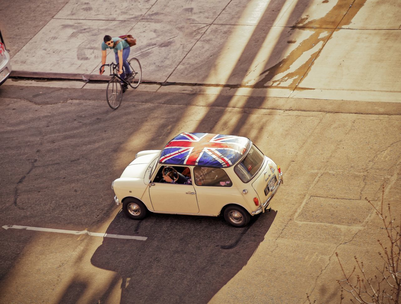 Travel on the street. Mini and bike. Automobile Bicycle Bike Vs Car British Car City Cycling Cyclist Day Driving Flying High High Angle View Mini Cooper Outdoors People Road Shadows Street Streetphotography Transportation Union Jack Urban