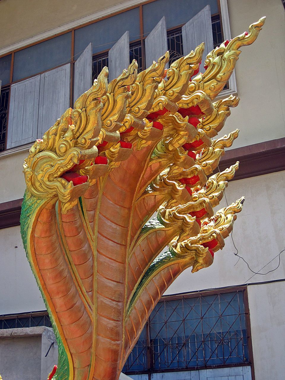 architecture, built structure, building exterior, day, outdoors, low angle view, chinese dragon, dragon, no people, city