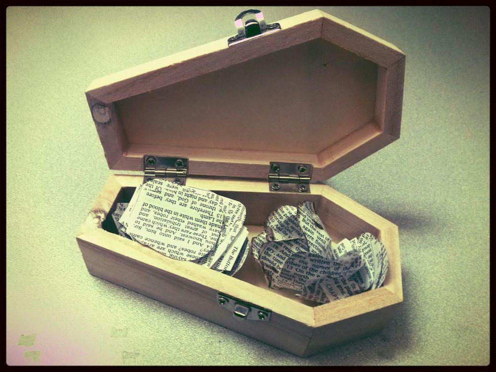 Page petals in a mini coffin