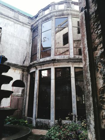 Creepy old haunted hotel Architecture History Abandoned Low Angle View