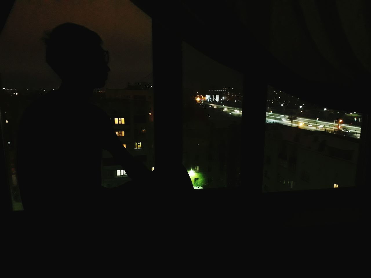 Just Sitting There Real People Shades Of Darkness One Man Only Window Looking Through Window One Person Only Men Standing Adults Only Men City Adult People Night Indoors  Cityscape
