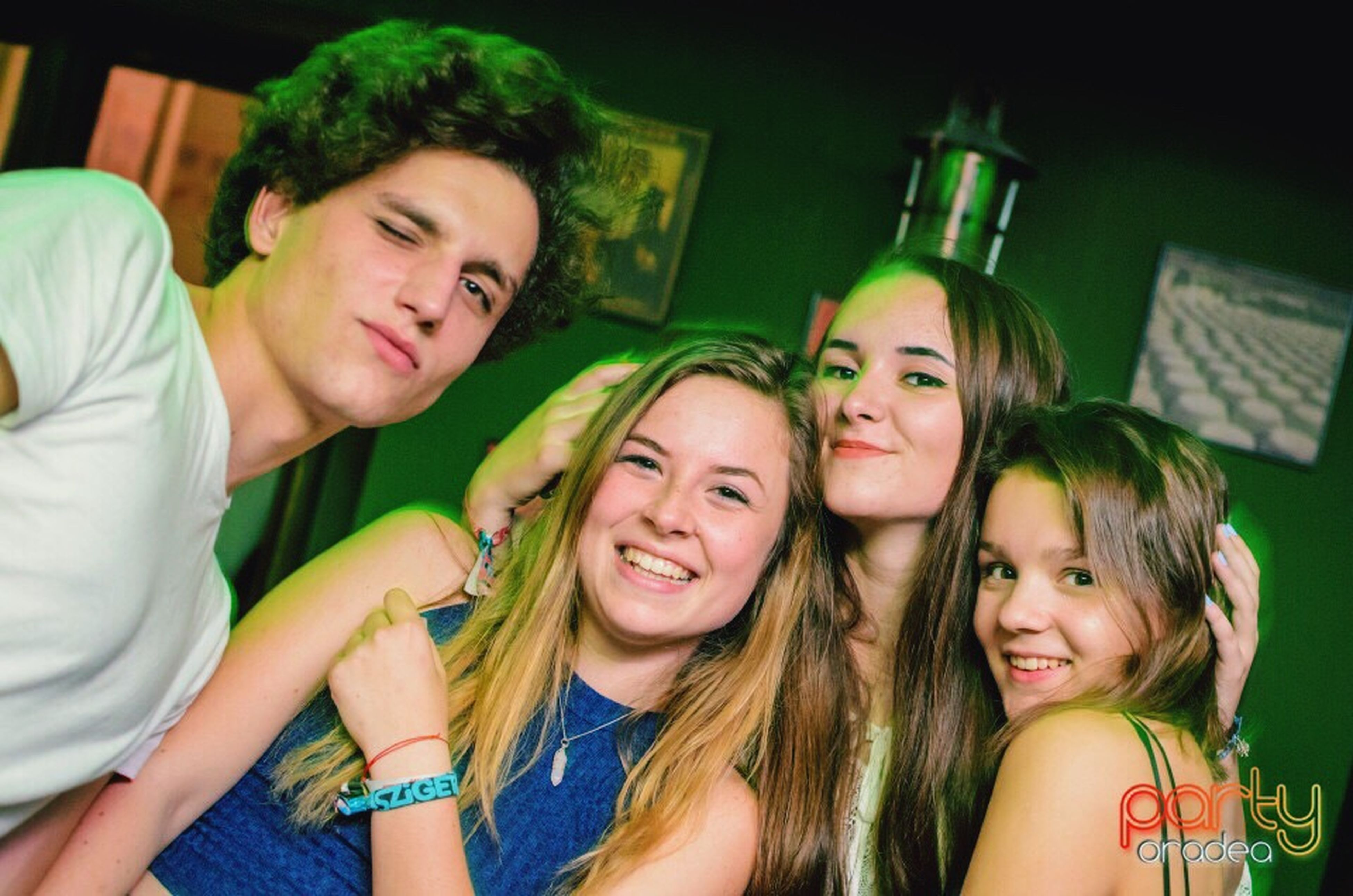 togetherness, leisure activity, lifestyles, bonding, friendship, love, teenage girls, young women, casual clothing, smiling, happiness, person, green color, family, front view, young adult, long hair, enjoyment, teenage boys, looking at camera