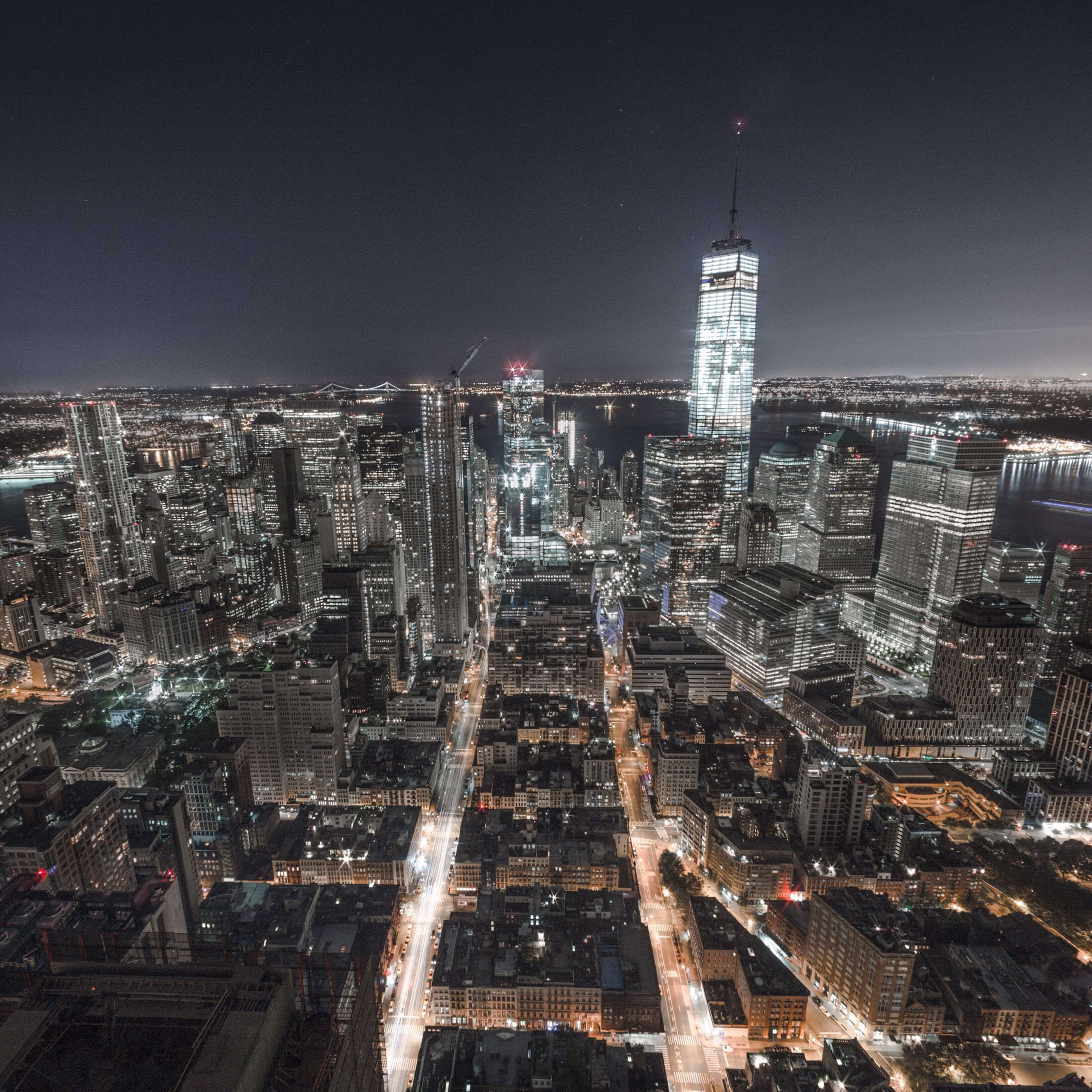 city, architecture, building exterior, cityscape, built structure, illuminated, skyscraper, night, tower, tall - high, crowded, modern, high angle view, office building, capital cities, financial district, city life, travel destinations, urban skyline, sky