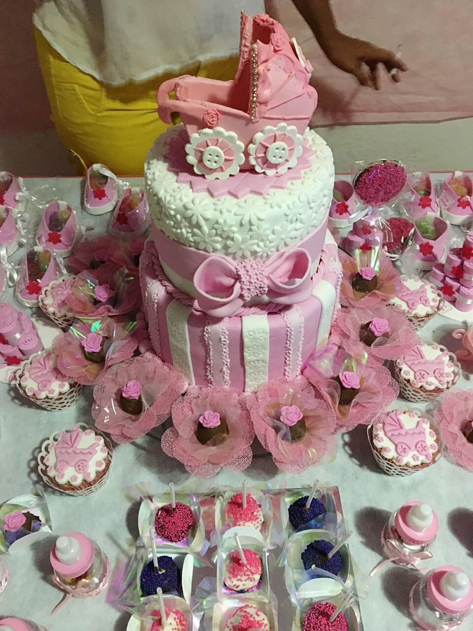 pink color, sweet food, celebration, indoors, indulgence, flower, variation, dessert, temptation, freshness, unhealthy eating, one person, wedding cake, close-up, life events, real people, day, food, people