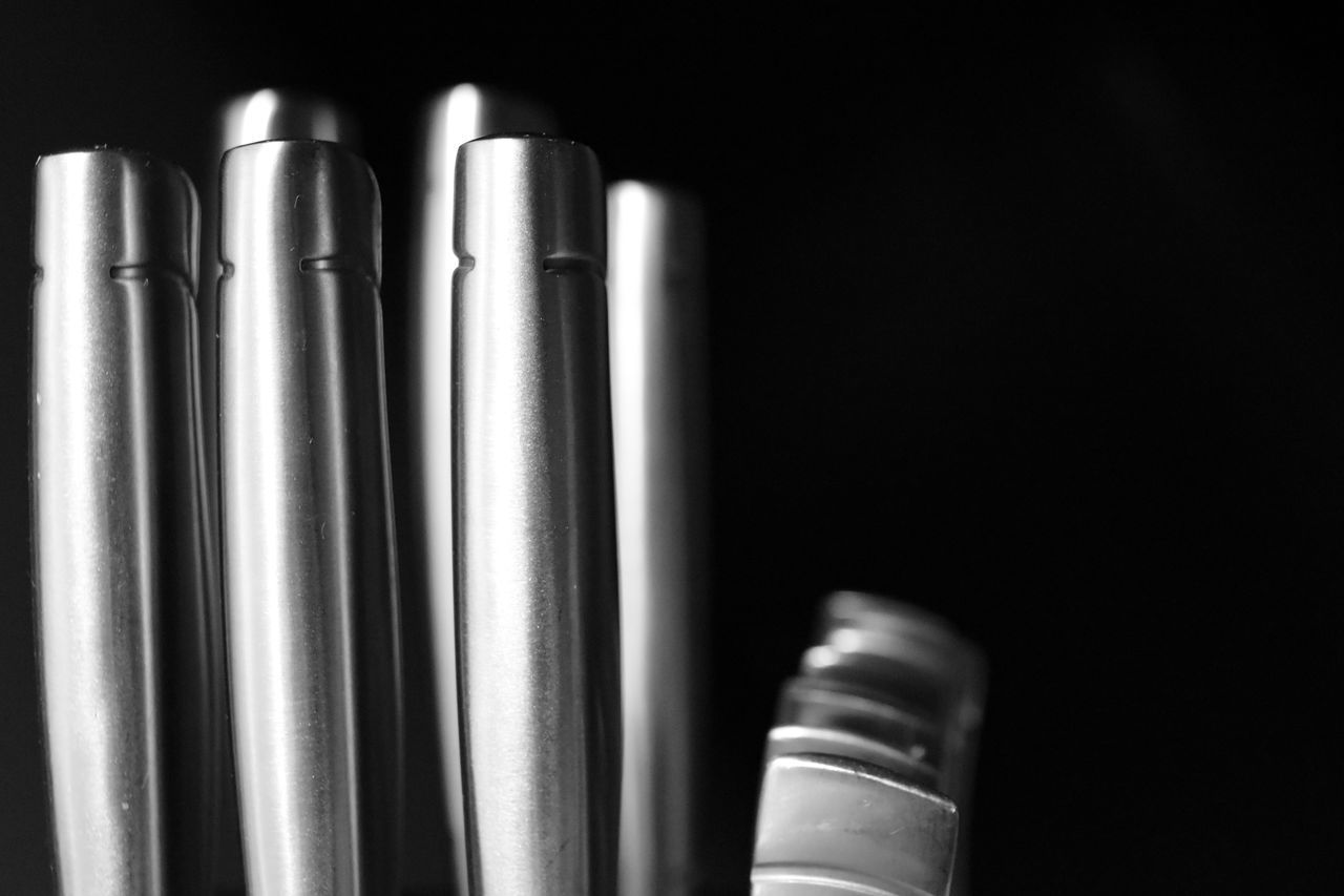 close-up of steel kitchen utensils Black And White With Black Background Black Background Close-up Day Depth Of Field Black And White High Contrast Black And White Indoors  Kitchen Utensils No People Steel Cutlery Symmetry Vertical Lines