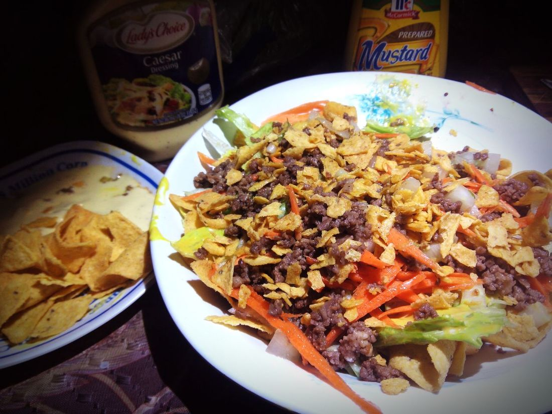 My own Taco Salad. Preparation time: 45 minutes. Tacos, Ground Beef with garlic powder and minced onion, sautéd in boiling butter, minced Cucumber, Carrot strips, Lettuce. Caesar Dressing and Mustard. It smells so good. Tacosalad Butter Food
