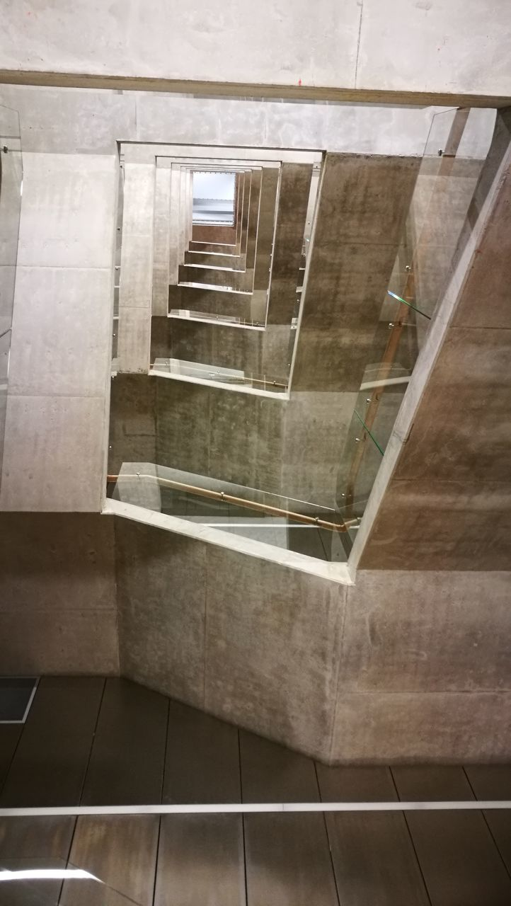 steps and staircases, staircase, steps, architecture, railing, built structure, indoors, stairs, hand rail, no people, spiral staircase, day, close-up