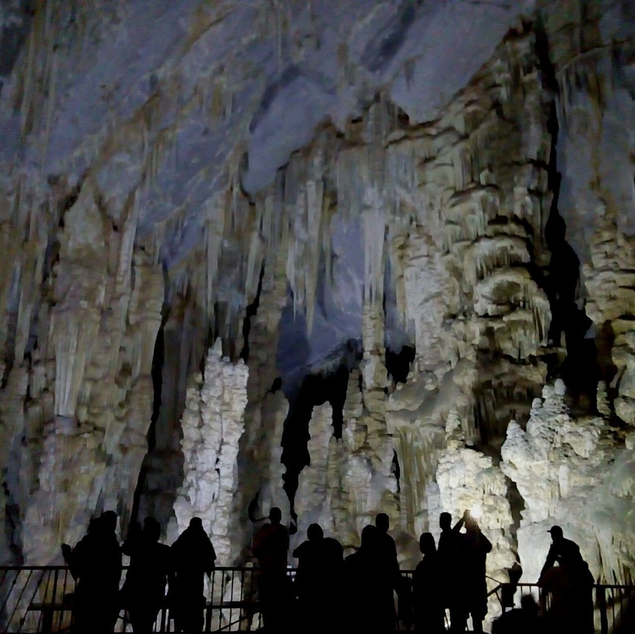 rock formation, cave, stalactite, rock - object, geology, physical geography, nature, real people, beauty in nature, textured, indoors, leisure activity, silhouette, low angle view, water, day