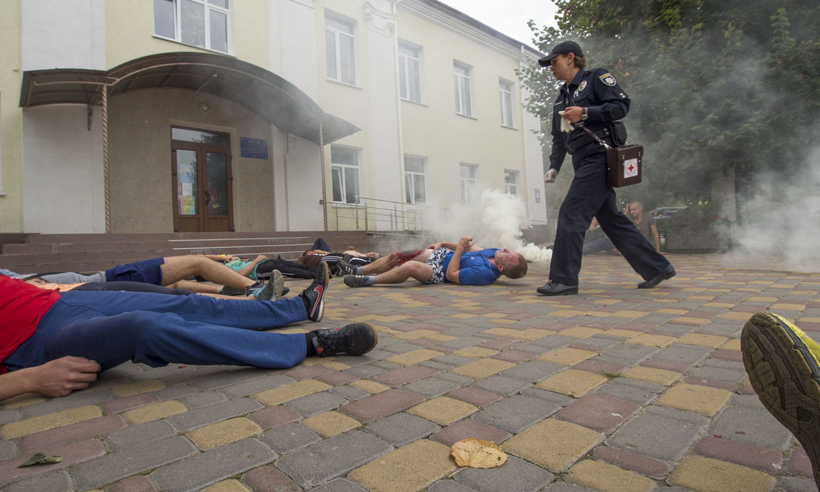 Red Cross held on Saturday, September 10, 2016, in Borispol, Ukraine training to rescue the wounded, the victims of the terrorist attacks. Architecture Attacks Building Exterior Built Structure Casual Clothing City Day Doctor  Full Length Leisure Activity Lifestyles Men Person Police Red Cross Relaxation Rescue Sitting Social Issues Terrorist Training Victims Wounded Young Adult Young Women