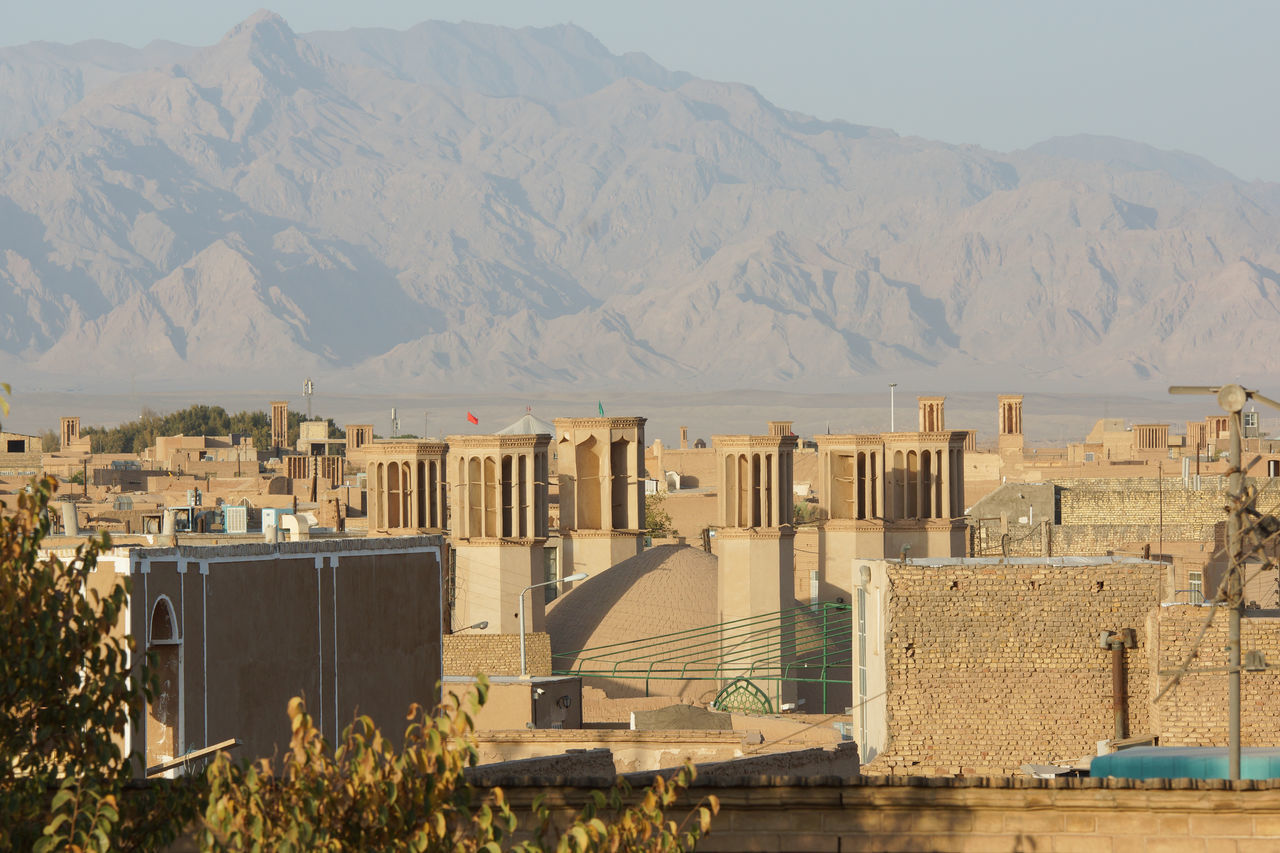 Panorama of Yazd on Sunset, Iran, Asia Architecture Building Exterior Built Structure Central Asia City Day Dusk Iran Middle East Mountain Mountain Range Nature No People Outdoors Panorama Scenery Sightseeing Silk Road Sundown Sunset Tourism Town Travel Travel Destinations Yazd