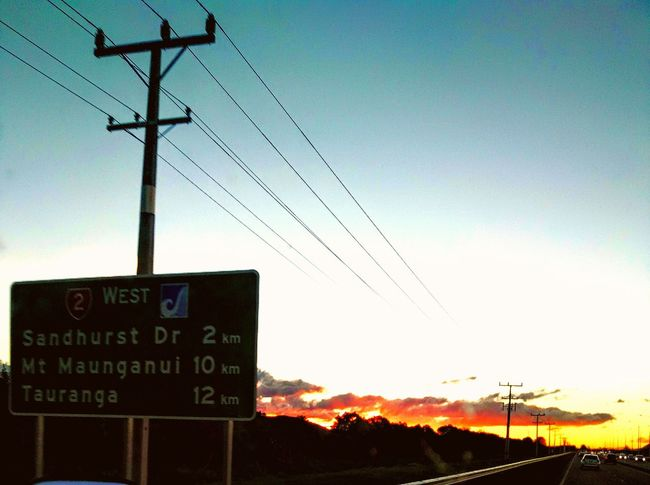 Sunset Motorway Sign On The Way Home