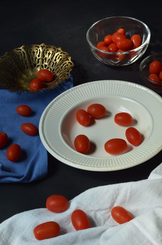 Grape tomatoes Bowl Dish Food Fresh Produce Freshness Grape Tomatoes Group Of Objects Indoors  Order Plate Red Serving Dish Still Life Tomato Tomatoes Vegetables