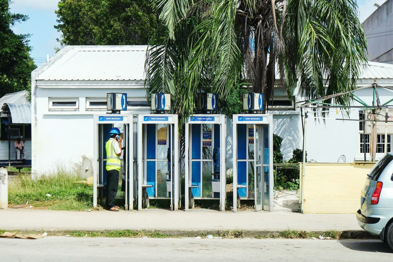 Calling in Barbados Tree Outdoors Building Exterior Day Built Structure No People Architecture Adapted To The City Fresh 3 People Summer EyeEm Best Shots Open Edit Adult Eye4photography  Streetphotography Streetphoto_color Street Photography On The Phone...