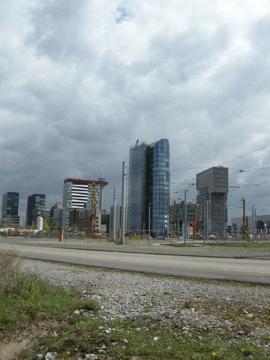 Architecture Building Built Structure City City Life Cloud Cloud - Sky Cloudy Day Development Diminishing Perspective Empty Grass Modern No People Office Building Outdoors Overcast Road Sky Surface Level Tall - High The Way Forward Vanishing Point Weather