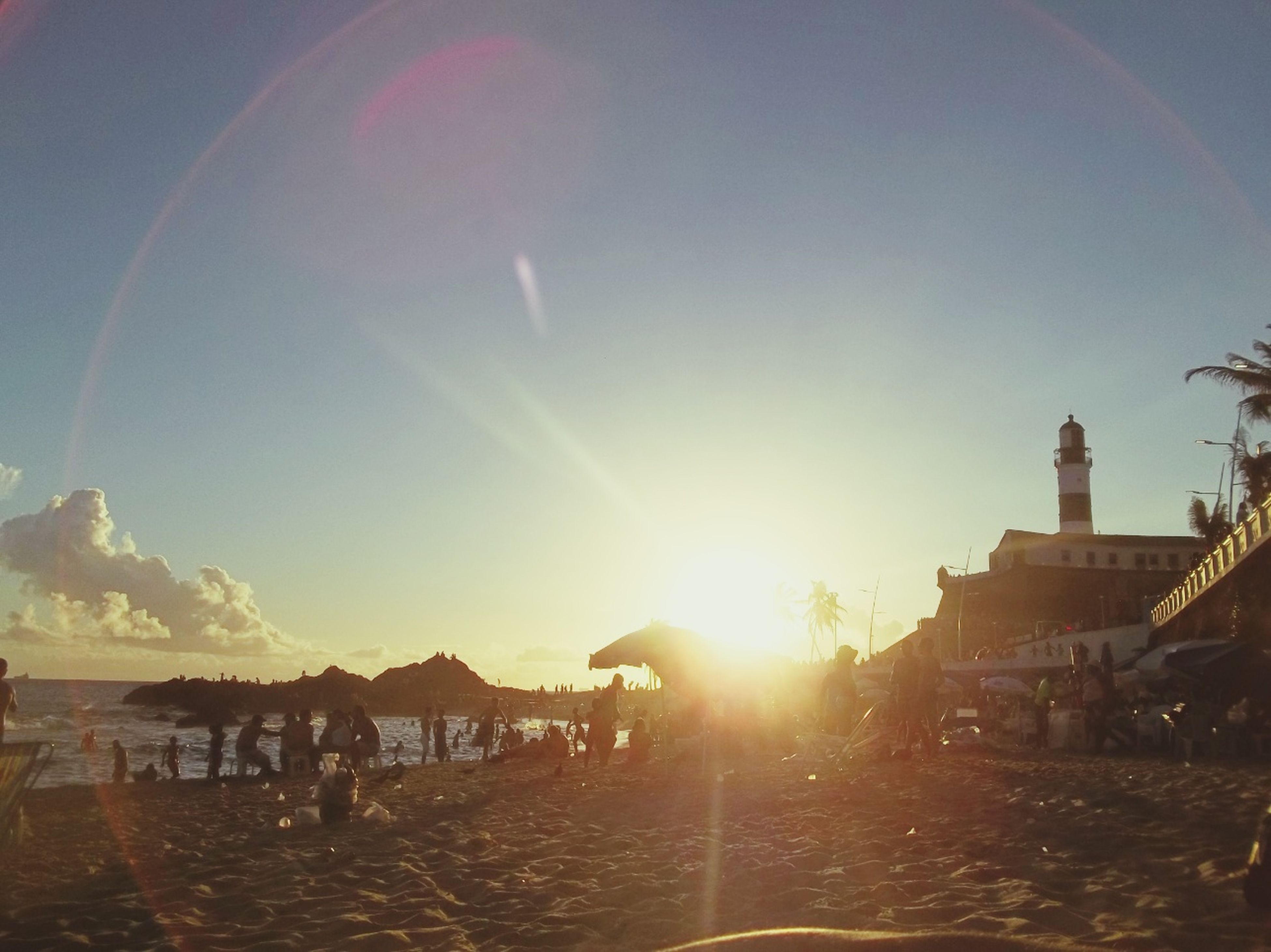 sun, sunbeam, lens flare, sunlight, built structure, building exterior, architecture, water, clear sky, sky, sea, bright, sunny, sunset, nature, scenics, beauty in nature, outdoors, copy space, beach
