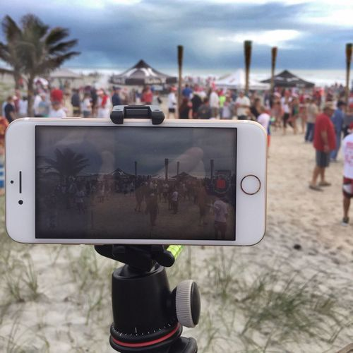 Phone photography Focus On Foreground Camera - Photographic Equipment Surfing Santas Cocoa Beach, Florida Photography Themes Photographing Large Group Of People Beach Photography Close-up Reflective Surface Redundant
