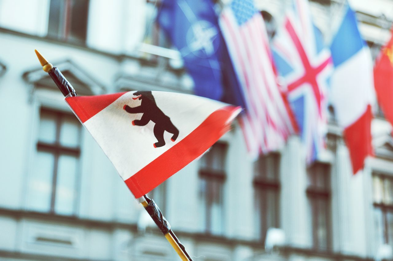 flag, patriotism, focus on foreground, close-up, no people, day, red, outdoors, building exterior