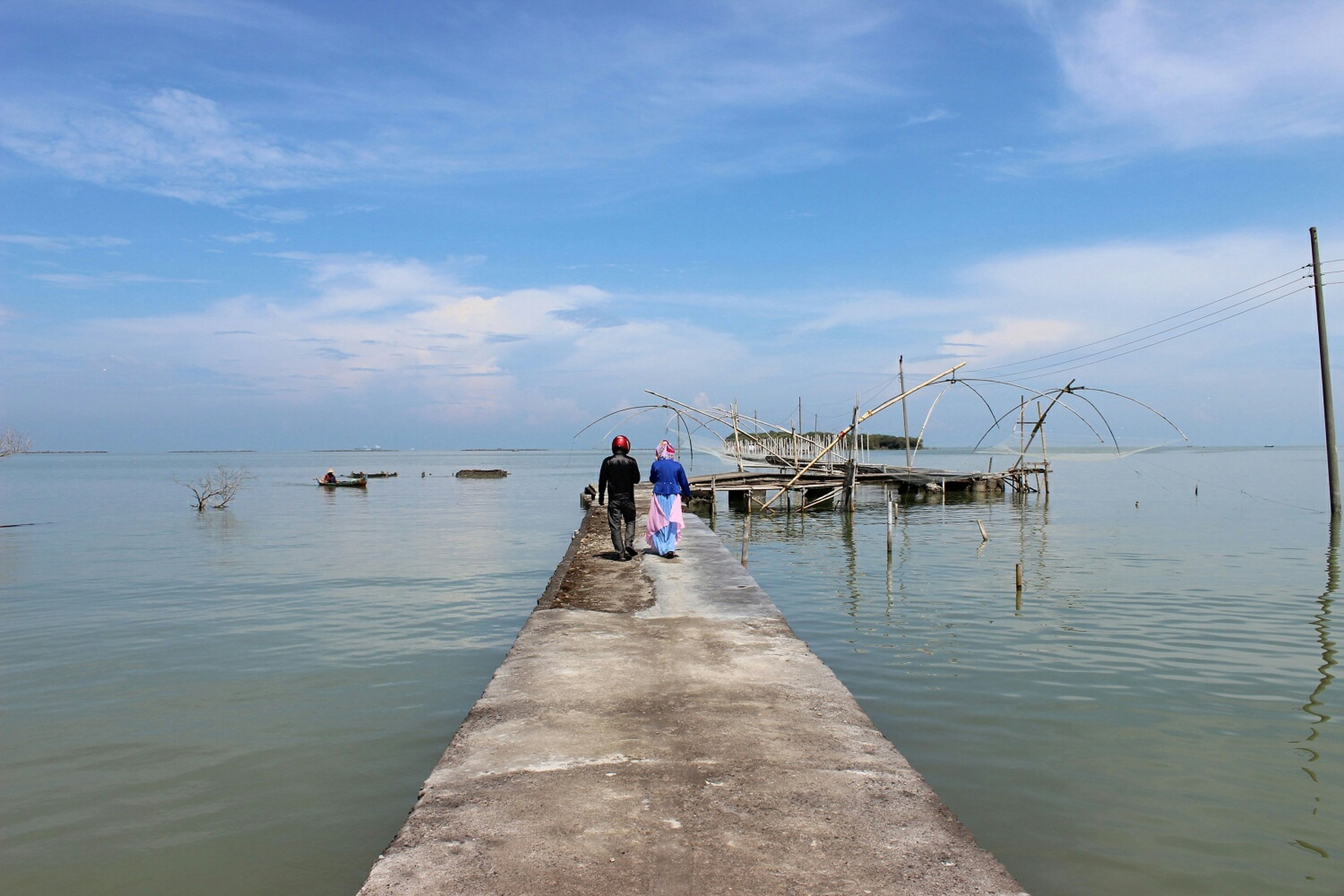 water, sky, sea, transportation, nautical vessel, horizon over water, cloud - sky, tranquility, the way forward, tranquil scene, nature, mode of transport, men, scenics, cloud, incidental people, day, beauty in nature, boat