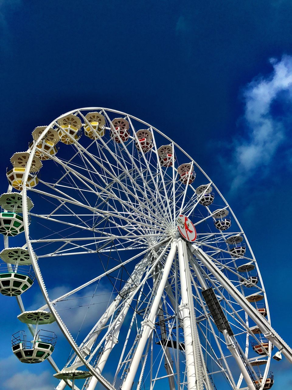 ferris wheel, amusement park, arts culture and entertainment, blue, amusement park ride, circle, sky, low angle view, leisure activity, outdoors, big wheel, day, no people