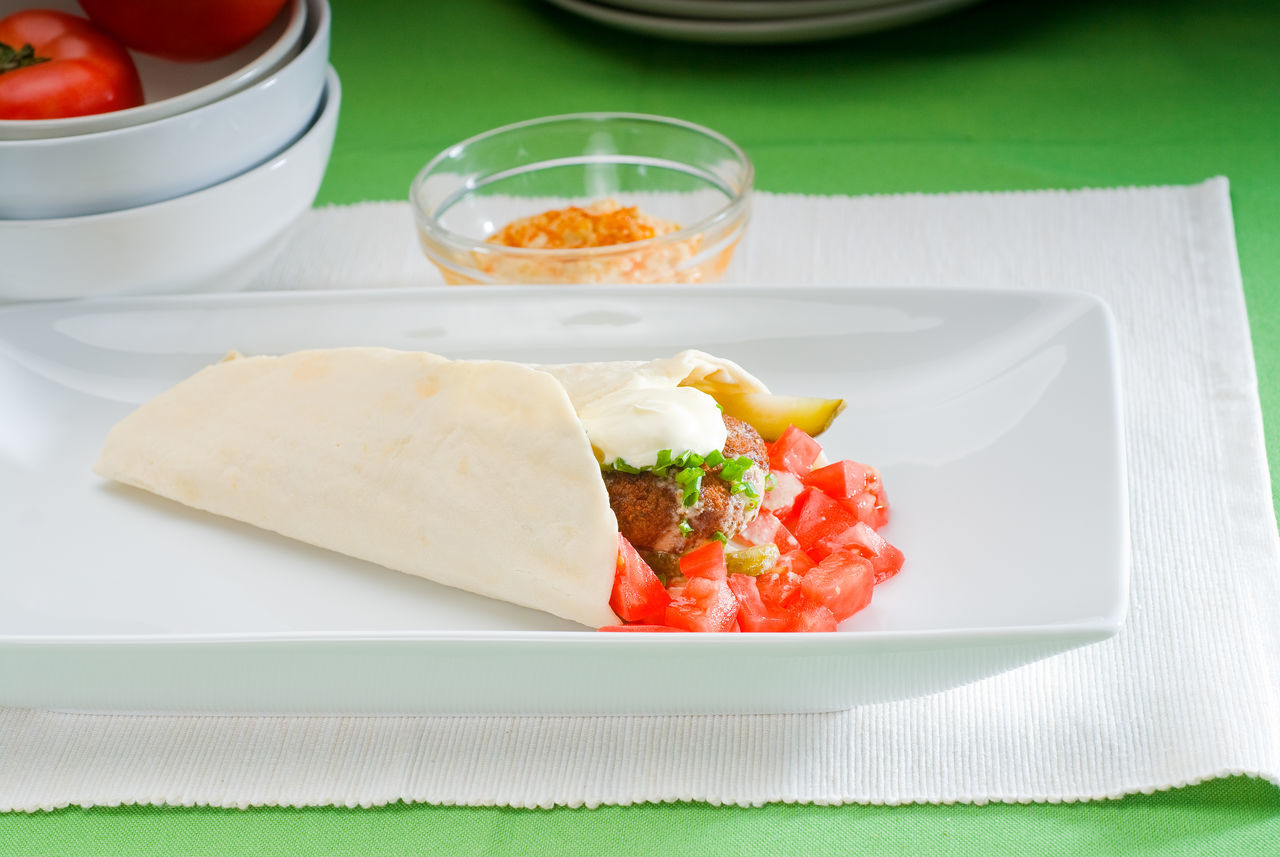 Close-Up Of Wrap Served In Plate