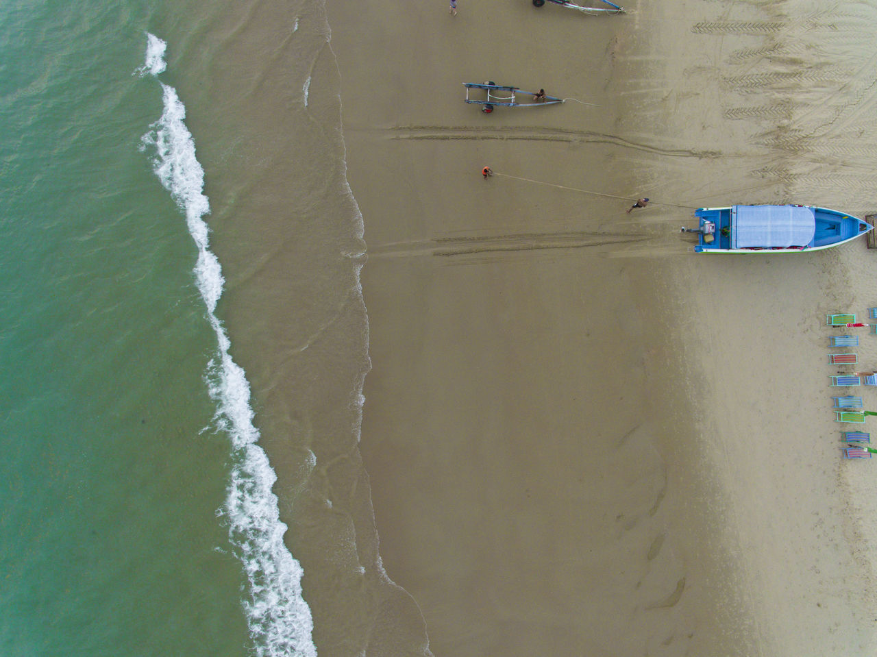 Boat, sand, waves, beach drone view from above Aerial View Waves And Sand Waves Below Looking Down From Above Looking Down Looking From Above Tourism Seaside Drone ViewHigh Angle View Outdoors Wave Sea Beach Looking Below Nature Split Layers Layers And Colors Layers And Textures Boat Ocean Flying High