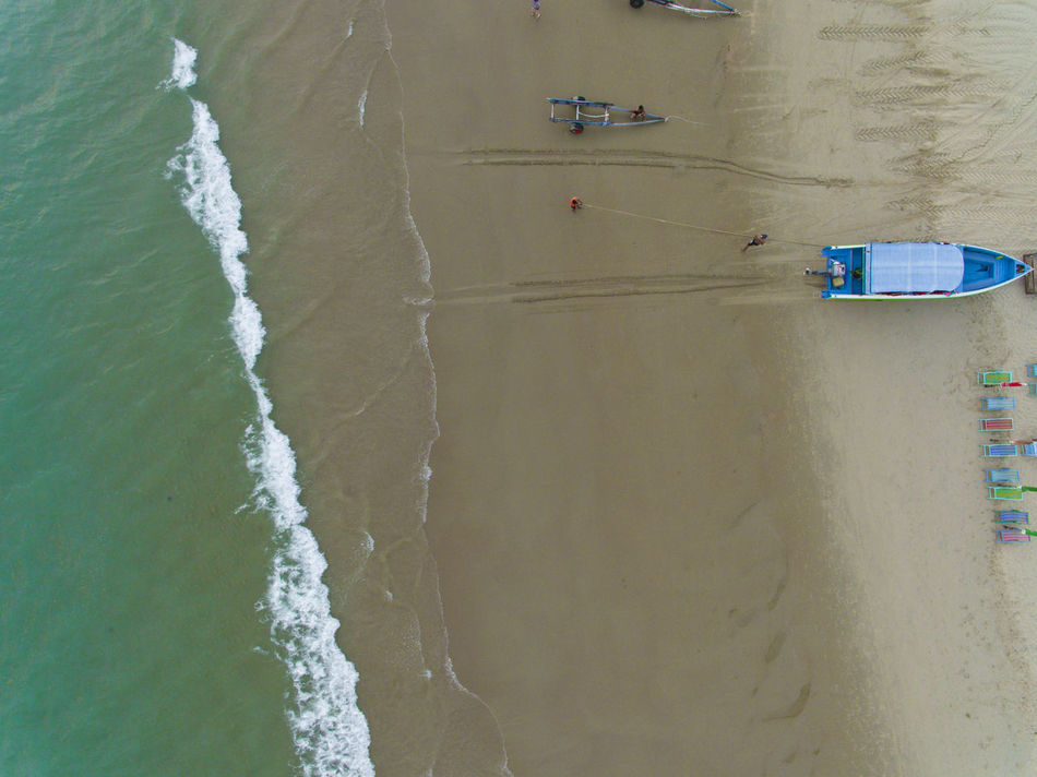 Boat, sand, waves, beach drone view from above Aerial View Waves And Sand Waves Below Looking Down From Above Rayong,Thailand Looking From Above Tourism Seaside Drone ViewHigh Angle View Outdoors Wave Sea Beach Looking Below Nature Split Layers Layers And Colors Layers And Textures Boat Ocean Flying High Sea View