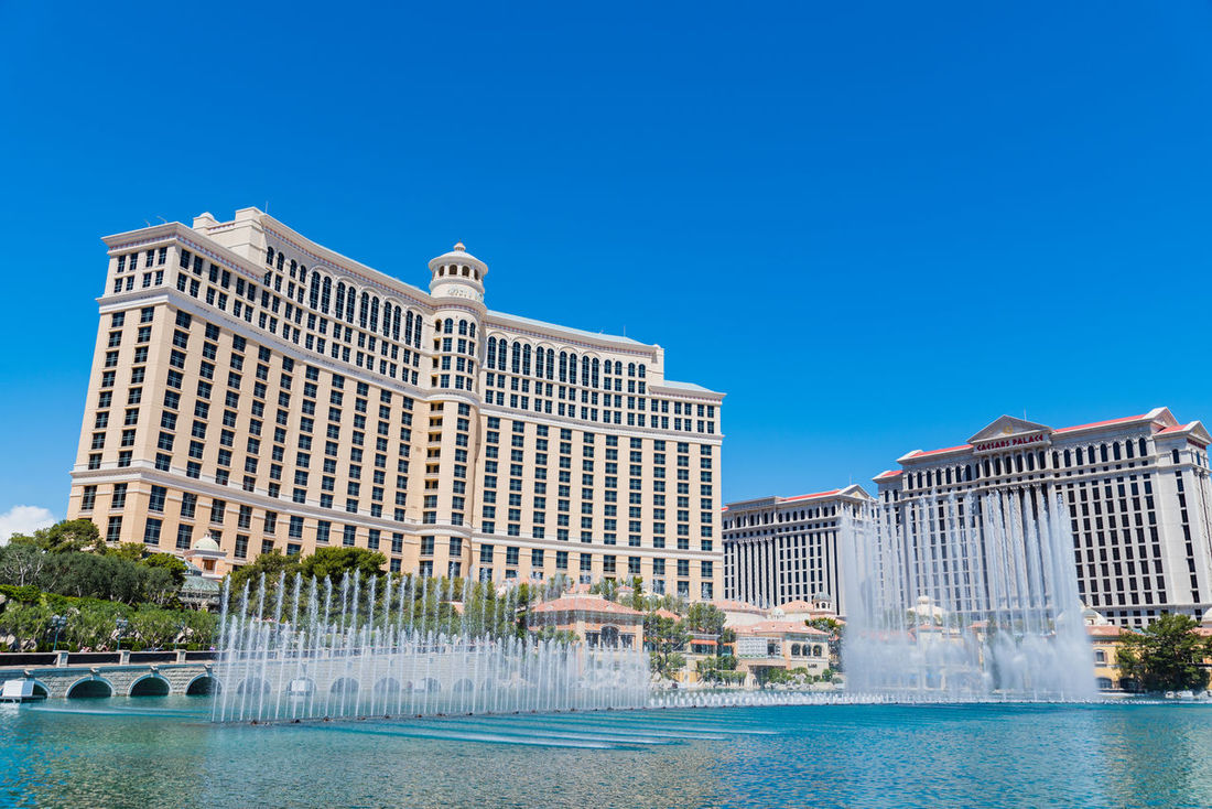 Architecture Blue Building Exterior Built Structure City Cityscape Clear Sky Fountain Fountain Show Hotel Landscapes Lasvegas Luxury Luxury Hotel Modern Outdoors Photography Sky Skyscraper Swimming Pool Travel Destinations Tree Urban Skyline Water Waterfront