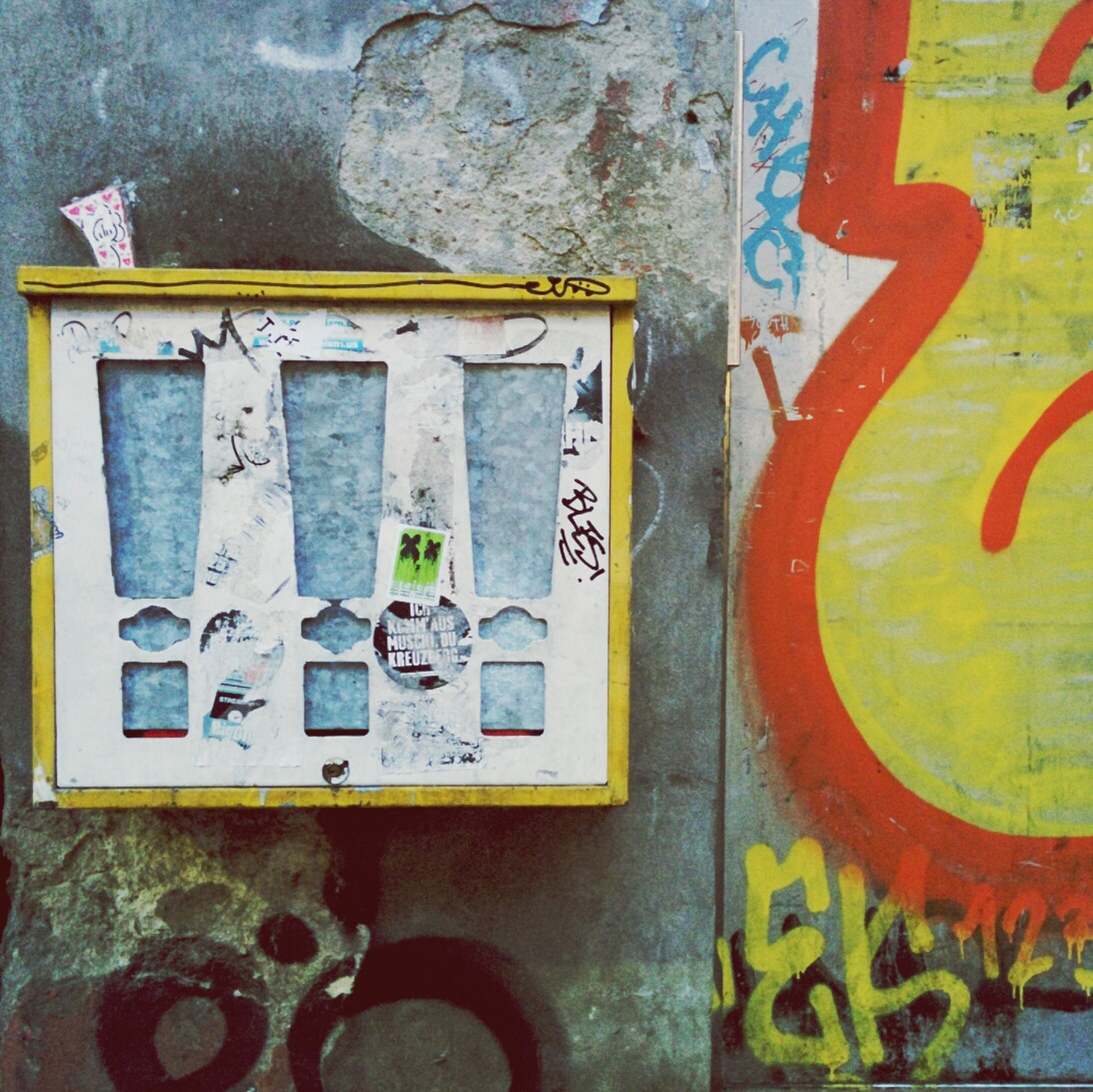 text, communication, wall - building feature, indoors, multi colored, western script, close-up, variation, graffiti, number, metal, wall, old, art and craft, full frame, no people, yellow, art, backgrounds, day
