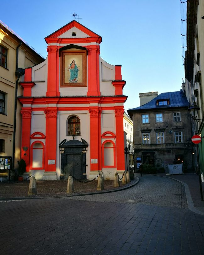 Red City Architecture Building Exterior Politics And Government Built Structure Outdoors No People Sky Day Clock Church Streetview Streetview Krakow Kraków, Poland Colour Building Architecture_collection Architecture Travel Destinations Color Color Building Contrast Red And Blue