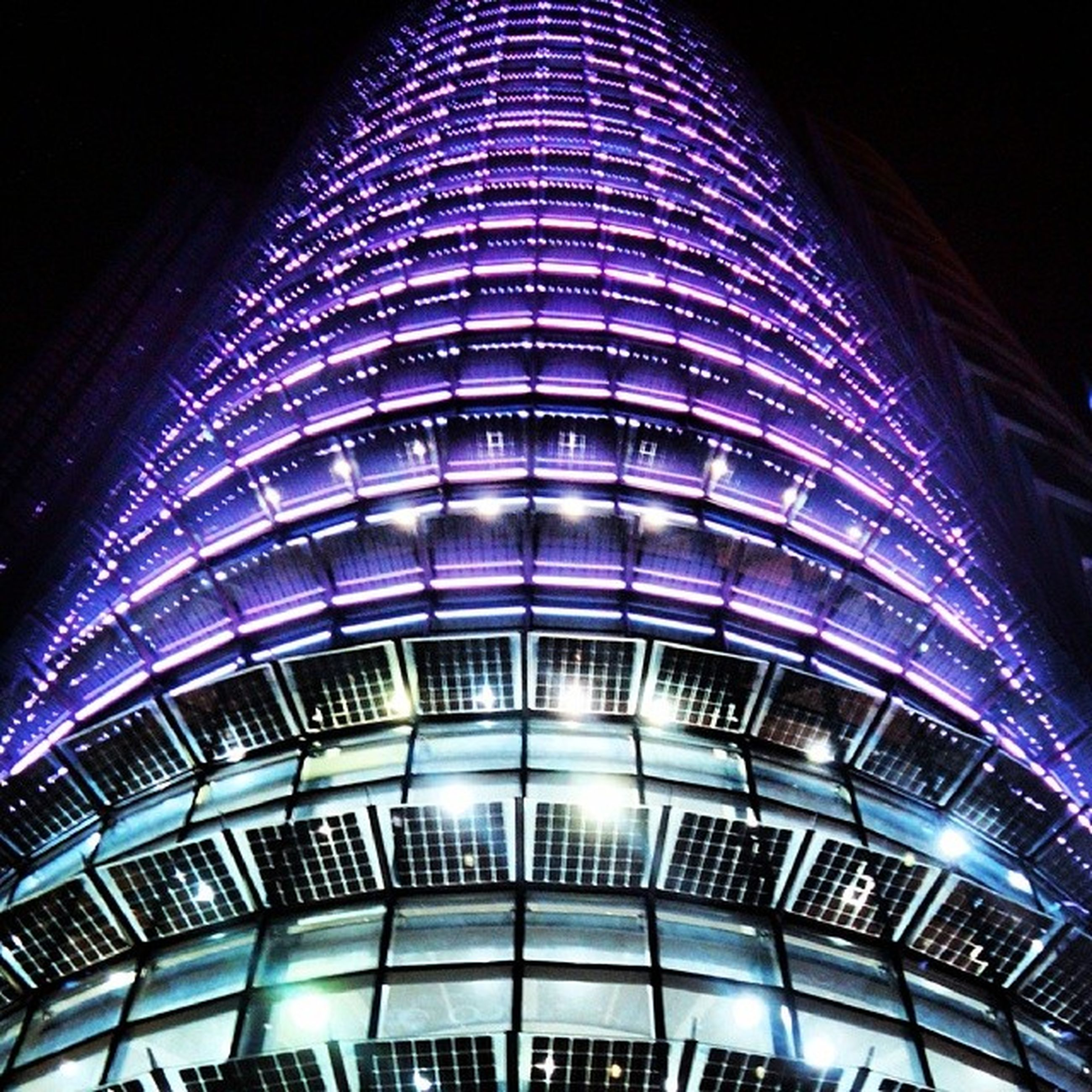 architecture, built structure, low angle view, illuminated, night, building exterior, modern, city, building, pattern, glass - material, window, no people, office building, indoors, skyscraper, architectural feature, reflection, railing