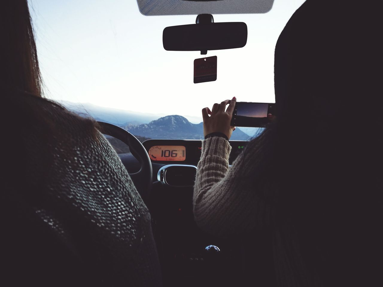 Travel between big mountains Transportation Travel Journey Driving Speedometer Vehicle Interior People Adults Only Two People Photographer In The Shot Picture In A Picture Beauty In Nature Mountains And Sky Mountain Peak EyeEm Best Shots Weekend