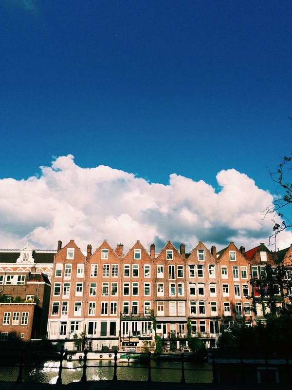 Hello Amsterdam! I am super happy to announce that thanks to the @team I will be hosting the Global EyeEm Adventure here! Join us for a pleasant wander through Amsterdam Noord! The album tag for the occasion is EEA3 - Amsterdam City Architecture Houses Tourism Façade Sunny Street