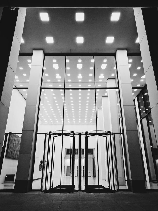 Glass - Material Indoors  Low Angle View Architecture Window Close-up Reflection Warehouse Modern Glass Entrance Day Geometric Shape Interiors Place Of Work No People Symbol Surface Level Blackandwhite Monochrome Photography Black And White